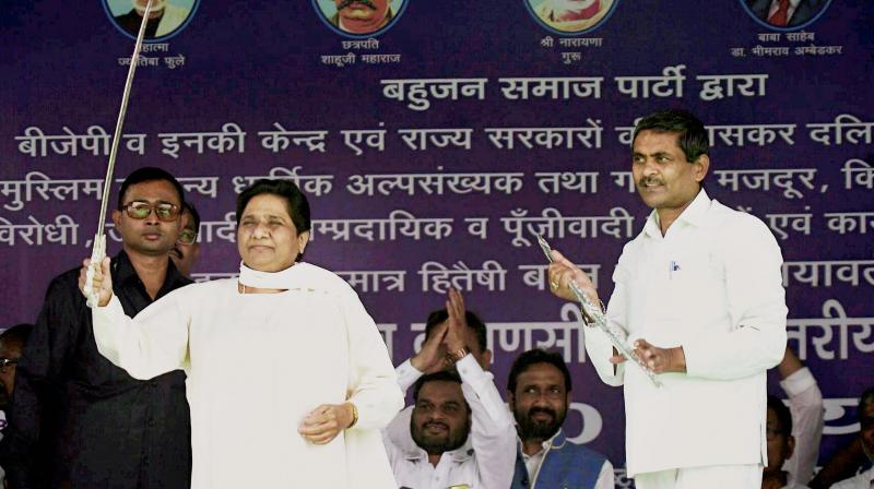 BJP hurting secular fabric, promoting RSS ideology: Mayawati