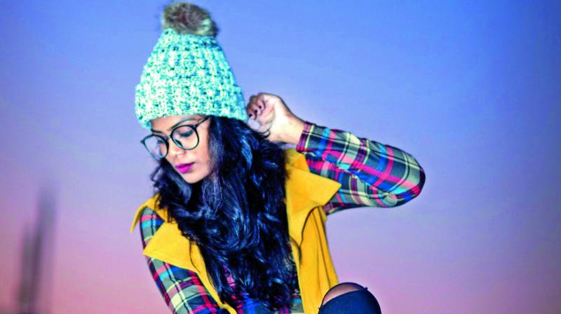Winter fashion: Wear a beanie to stay warm. Plaid shirts and overcoats look great.
