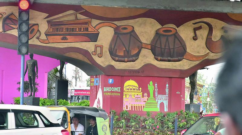 Painting being done at the Hitec City flyover in Hyderabad on Tuesday. (Photo: DC)