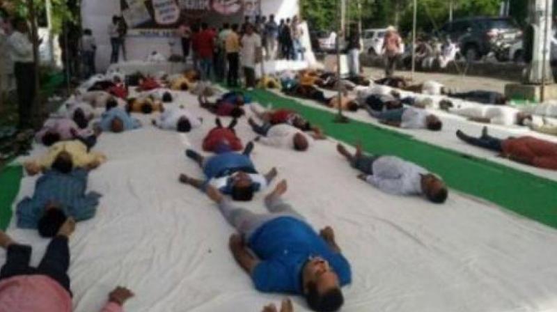 Congress workers, protesting farmers perform 'shavasana' in MP