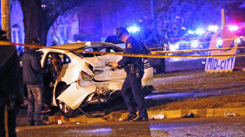 A suspect is in custody after 28 people were injured when a vehicle plowed into a crowd watching the Krewe of Endymion parade in the Mid-City section of New Orleans.