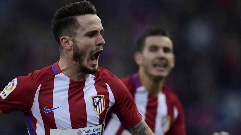 Atletico Madrid ties midfielder Saul Niguez through 2026