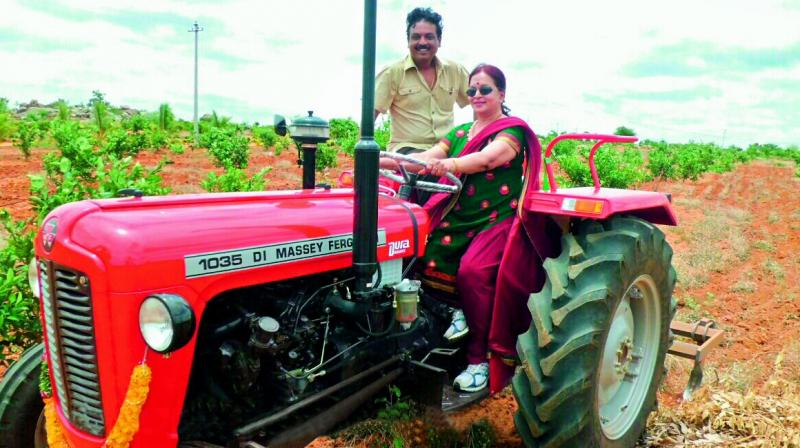 Actor Naresh with his mother Vijaya Nirmala on a tractor in their farm on the outskirts of Hyderabad