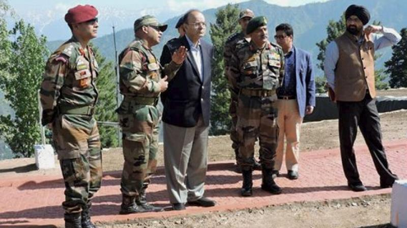 Defence Minister Arun Jaitley with GOC of Baramulla based Division, Maj Gen RP Kalita during a visit to the forward areas of Rampur Sector of North Kashmir on Friday. (Photo: PTI)