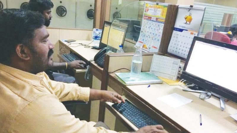 MBA graduate C. Venkateswaran, formerly a marketing executive in a beach mineral mining company at Thisayanvilai, is now an auto-driver in the town.(Photo: DC)