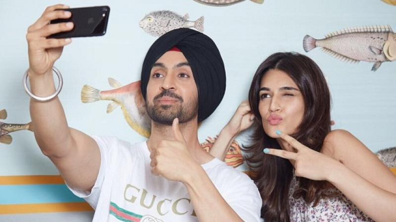 Sanon shared a series of photograph of herself along with Dosanjh and director Dinesh Vijan.
