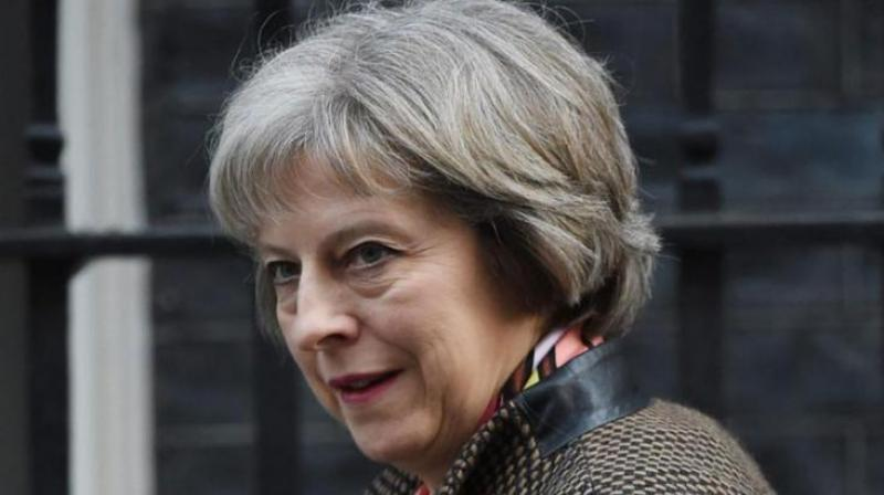 Brexit to go on, says May as she forms minority government