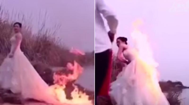 The video of the Chinese bride shows her photographer lighting the fire but things take a turn for the worse unlike what they expected. (Photo: Youtube)