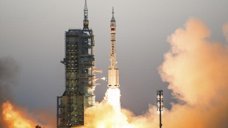 China's Shenzhou 11 spaceship onboard a Long March-2F carrier rocket takes off from the Jiuquan Satellite Launch Center in northwest China's Gansu province on Monday Oct. 17, 2016. China launched a pair of astronauts into space Monday on a mission to dock with an experimental space station and remain aboard for 30 days in preparation for the start of operations by a full-bore facility six years from now. (Photo: AP)