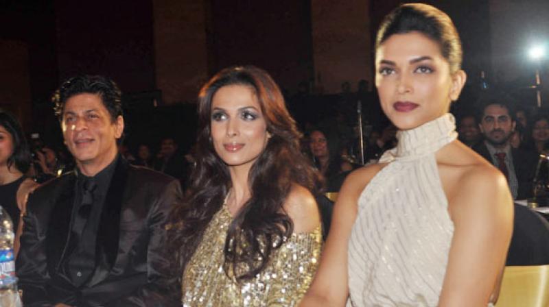 Shah Rukh Khan, Malaika Arora Khan and Deepika Padukone.