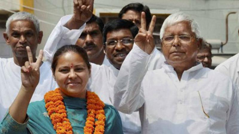 RJD chief Lalu Prasad along with his daughter and party candidate from Patliputra Misa Bharti.