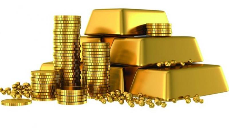 Gold extends losses, down Rs 200 on muted demand
