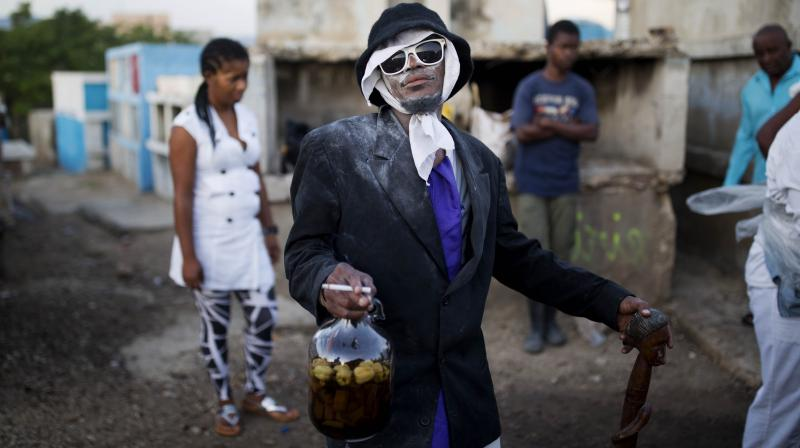 Revellers stream into cemeteries across the country, in a two-day celebration, to honour Baron Samedi, the guardian of the dead and ruler of the graveyard, and the rest of the Gede spirits which represent death and fertility. (Photo: AP)