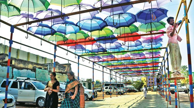 Visitors walk under the new umbrella roof towards the Meenakshi Amman temple entrance from the parking  sc 1 st  Deccan Chronicle & Madurai: Colourful umbrellas set new pilgrim ambience memphite.com