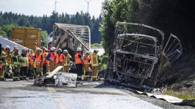 17 people were feared dead after a tour bus burst into flames following a collision with a trailer truck in southern Germany on Monday.