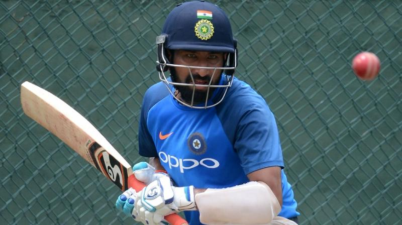 Cheteshwar Pujara, who produced back-to-back big knocks in the Ranji Trophy, was concentration personified during a practice session ahead of the Test series against Sri Lanka.(Photo: AFP)
