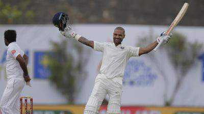Shikhar Dhawan celebrates after getting to his fifth Test century.  (Photo: AP)