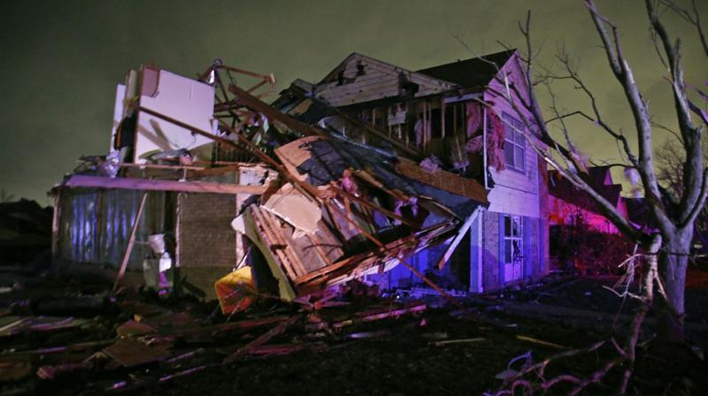 14 killed in brutal tornadoes and floods in south and midwest US