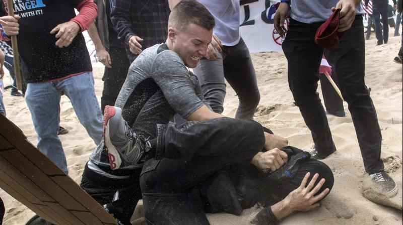 "The ""Make America Great Again"" march at Bolsa Chica State Beach, California, in support of US President Donald Trump brought together thousands of pro- and anti-Trump supporters. Soon after the march started, a scuffle broke out between the two parties. (Photo: AP)"