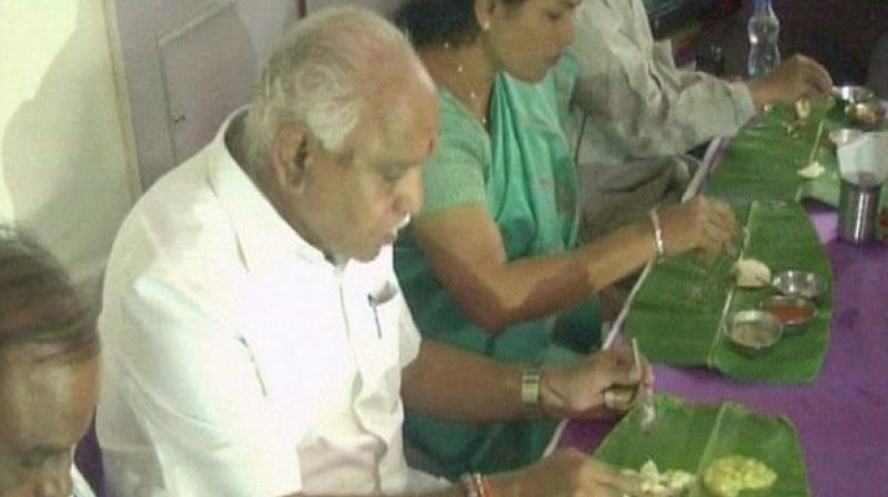 Yeddy chokes on idli controversy, orders food from restaurant at Dalit home