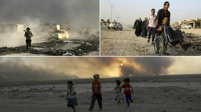 Dozens of men, women and children escaped from the village of Mdaraj south of Mosul, some on foot and others with vehicles, and now wait as police search their belongings. (Photos: AP)