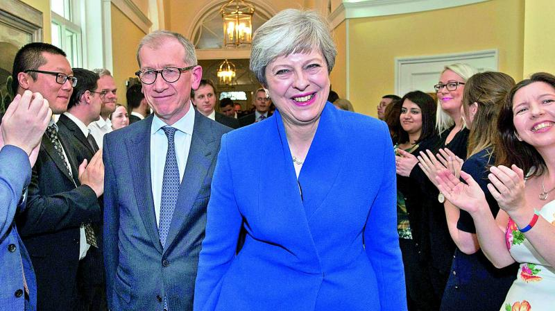 May's top 2 aides quit after election criticism