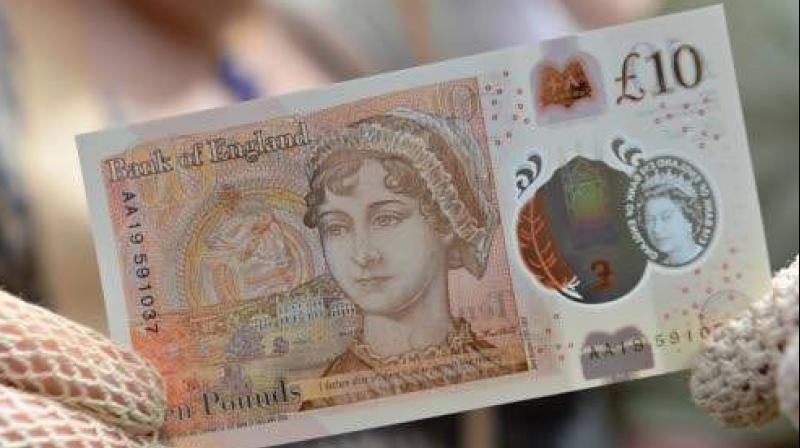 One of the new ten pound notes featuring author Jane Austen duting its launch at Winchester Cathedral in Winchester southern England