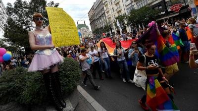 Serbian gay right activists marched with their first openly lesbian prime minister through the streets of Belgrade on Sunday, amid tight security.