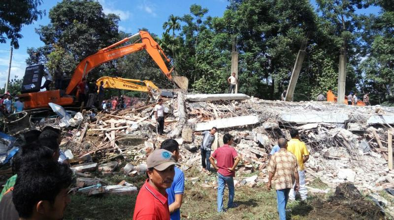 A strong undersea earthquake rocked Indonesia's Aceh province early on Wednesday, killing at least 52 people and causing dozens of buildings to collapse.