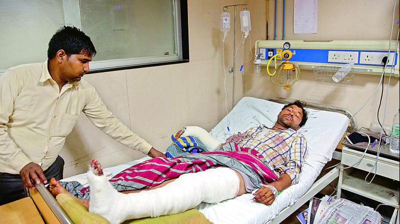 Image result for In Saharanpur, another youth shot at, UP govt suspends DM and SSP,