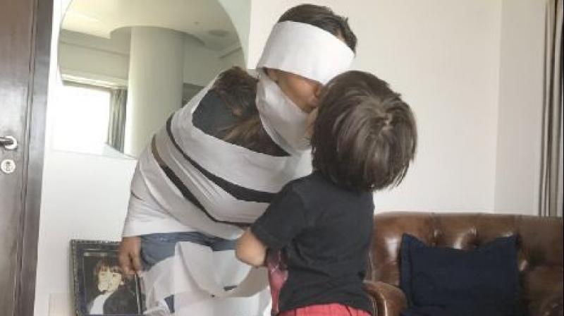 Little AbRam 'Mummifies' Mommy Gauri Khan Using A Toilet Paper
