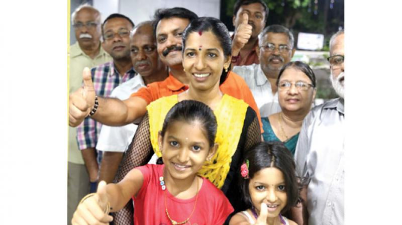 Girish Kumar and his family from Kakkanad were lucky to get the first tickets from Palarivattom Metro station. They stood in the queue for nearly an hour on Monday to get the tickets. (Photo: DC)