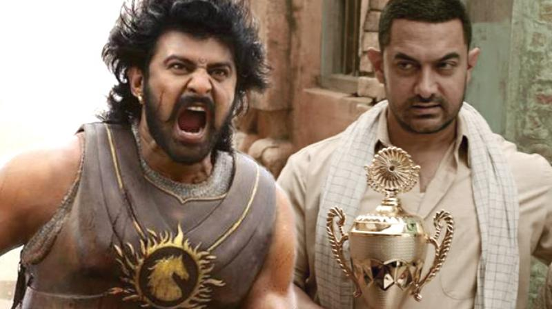 Prabhas in a still from 'Baahubali', Aamir Khan in 'Dangal.'