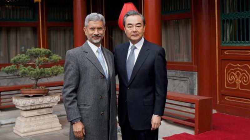 Foreign Secretary, S. Jaishankar with Chinese Foreign Minister Wang Yi before a meeting in Beijing on Wednesday. (Photo: PTI)
