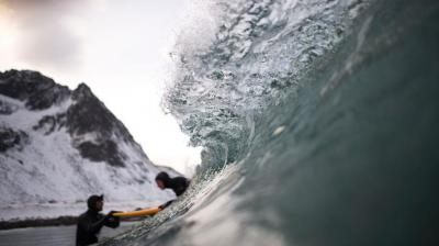 Norwegian surfer Tommy gives a surfing lesson to beginners in Flakstad, near Unstad.