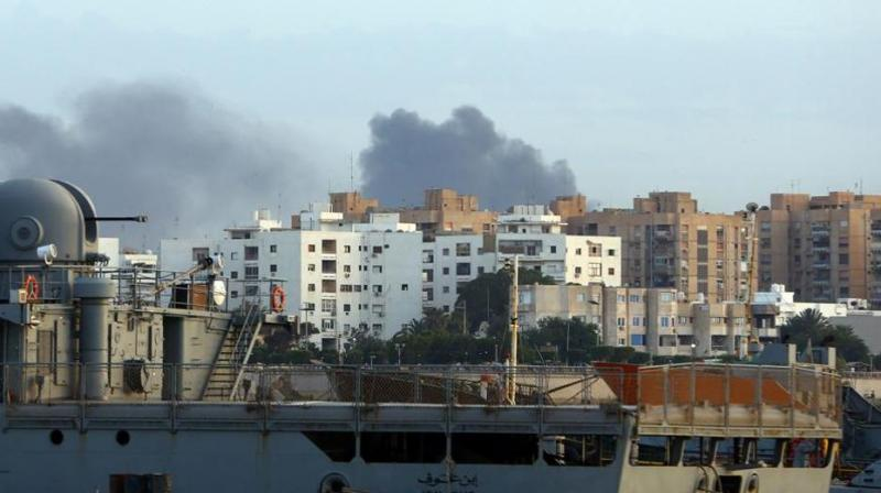 Smoke rises in the centre of the Libyan capital of Tripoli after clashes.(Photo: AFP)
