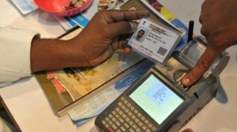RBI clarifies linking Aadhaar to bank account mandatory