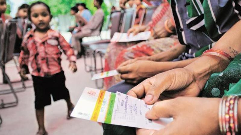 Put mandatory Aadhaar linking with bank accounts on hold:AIBOC