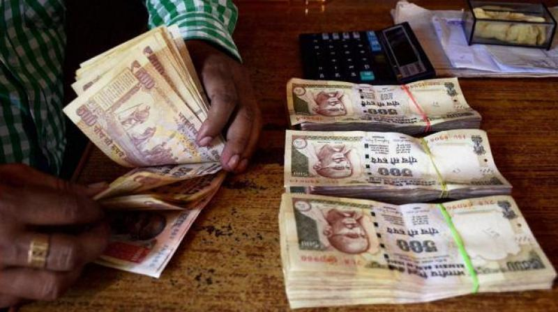 """The Income Tax Department will soon issue notices to those who have deposited """"suspicious"""" amounts of money in banks post-demonetisation and have not responded to taxman's preliminary communication. (Photo: PTI)"""