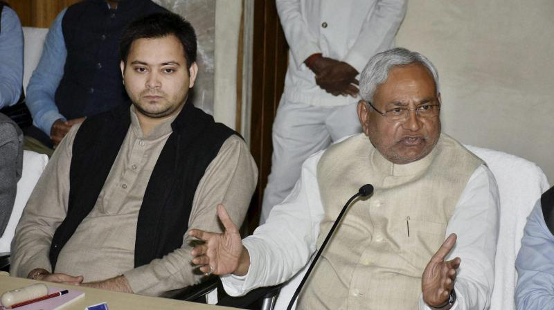 Bihar CM Nitish Kumar addresses a press conference along with deputy CM Tejaswi Yadav at the
