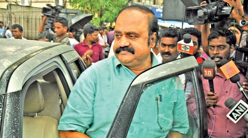 V. Pugazhendi a loyalist of TTV Dhinakaran and the Karnataka state secretary of AIADMK appears before the I-T department on Monday responding to their summons