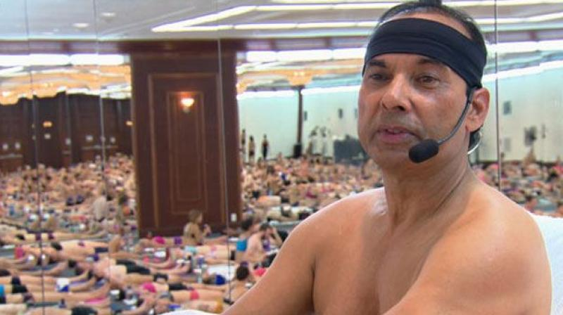 Warrant issued for Bikram founder beset by legal woes