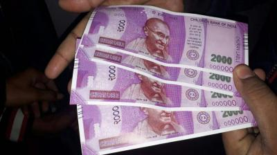 Fake notes of Rs 2000 which were dispensed by an SBI ATM in south Delhi on Wednesday. (Photo: PTI)