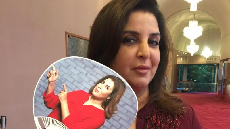 Farah Khan with customised hand-fan with her picture on it at the opening night of her film 'Om Shanti Om's play.