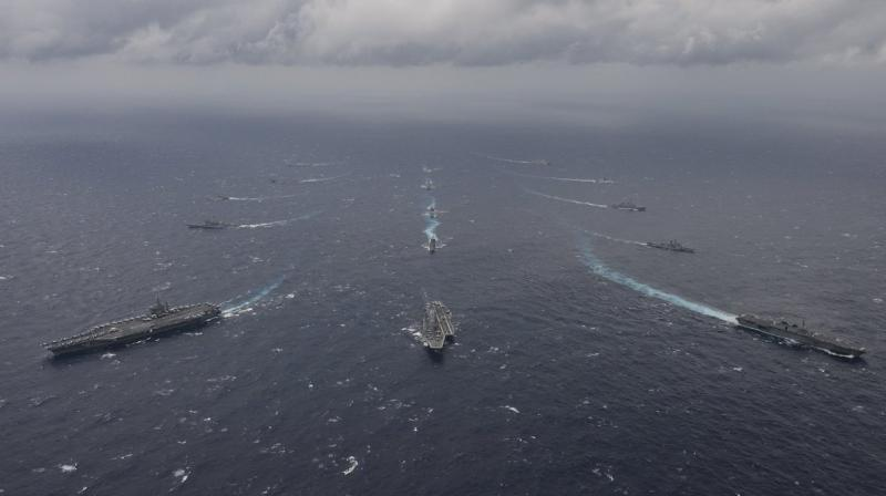 A week-long joint naval exercise between India, Japan and United States that took place last week, involved ships and aircraft from all three nations. (Photo: Indian Navy Twitter)