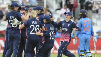 The England team celebrate the wicket of Smriti Mandhana in the final of the ICC Women's World Cup(Photo: AP)