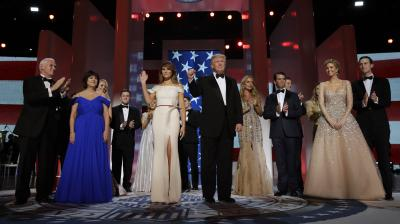 Donald Trump was sworn-in as the 45th president of the United States, putting Republicans in control of the White House for the first time in eight years. President Donald Trump acknowledges the crowd with Melania Trump, Vice President Mike Pence and his wife Karen, left, and their families at the Freedom Ball in Washington.