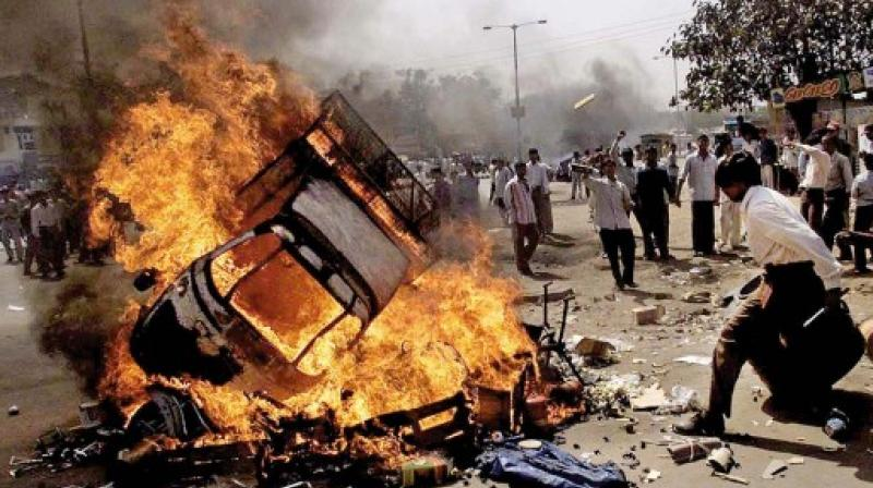 Protesters burn vehicles in Ahmedabad, during 2002 Gujarat riots. (Photo: AP)