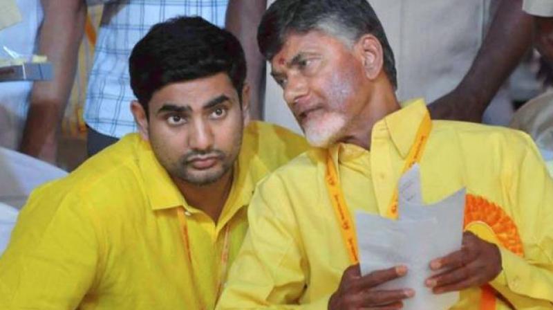 Andhra Pradesh Chief Minister Chandrababu Naidu and his son Nara Lokesh. (Photo: PTI)