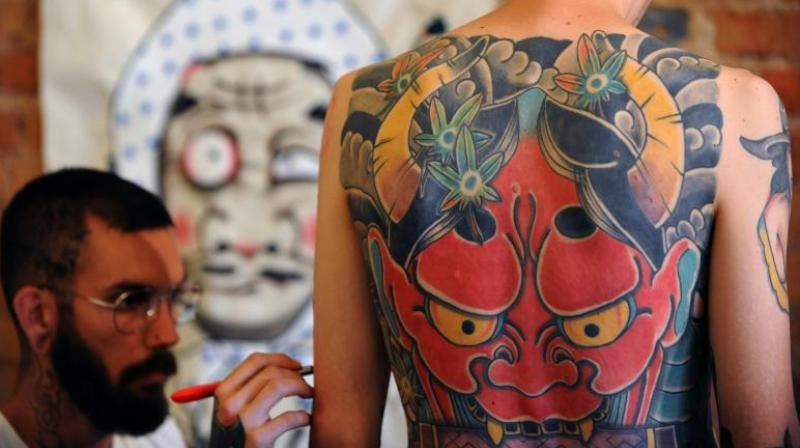 Just 43 percent of tattoo artists surveyed for the study said they had received training on how to handle skin with moles, spots or other skin lesions. (Photo: AFP)